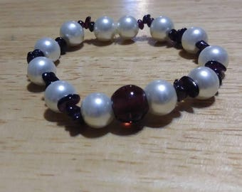 Handmade bracelet using stretchy chord and beautiful glass beads. Custom design. One of a kind.