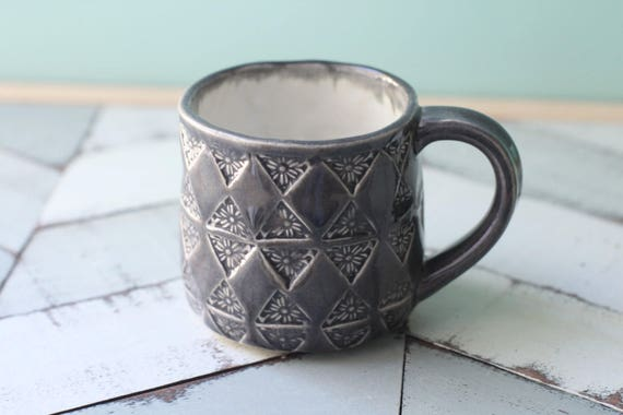 grey mug with triangle pattern