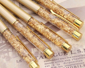 Gold pen with gold sparkles.