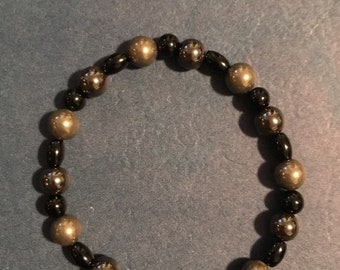 POWER BRACELET made of pyrite, onyx and hematite on an elastic band.