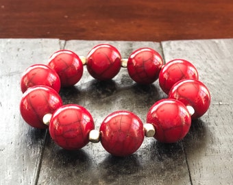 Red Marble - stretch bracelet with red resin beads and silver toned separators