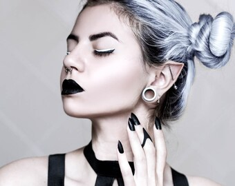 """The """"Rebel"""" midi ring in black - A wickedly curved middle-knuckle ring that narrows to a spike."""