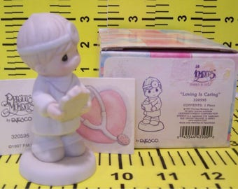 Precious Moments Little Moments. Loving is Caring. 320595. 1997. By Enesco. Retired.  Excellent Condition.