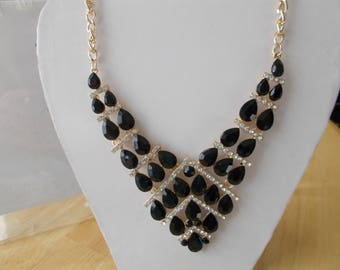 Bib Necklace with Black Crystal and Clear Rhinestone Beads on a Gold Tone Chain