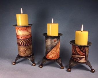 Set of three ceramic candle holders