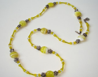 Yellow glass beads with floral spacers