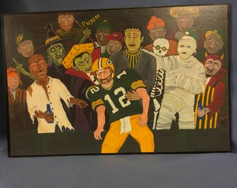 "Halloween movie monsters meet the Packers in a ""Lamboo Leap"" original print on panel"
