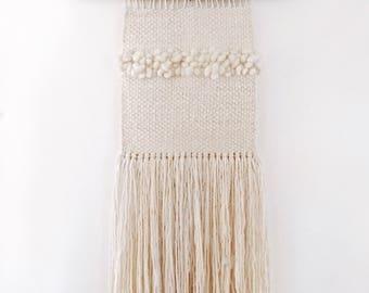 Bone, wall hanging by/ pacific loom
