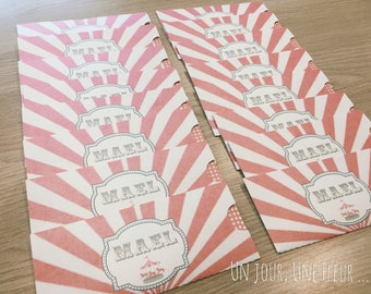 In the shape of a circus theme ticket invitation