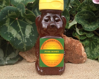 12 of our 8 oz. Plastic Squeeze Honey Bears Raw Wildflower Honey