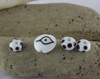 Set of 4 hand made glass beads