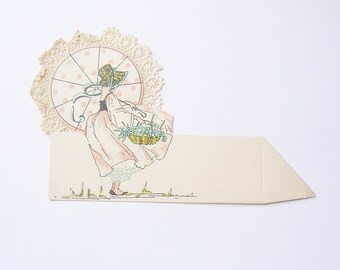 Vintage wedding place card flower girl in pink dress with lacy umbrella ephemera