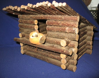 Rustic wood birdhouse. Decorative cabin, cottage, craft.
