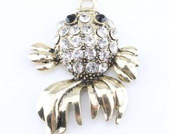 White fish of brass and rhinestone pendant