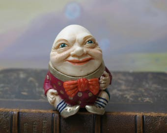 Figurine Humpty Dumpty red jacket with polka dots. Alice's Adventures in Wonderland. Humpty and Alice.  Through the Looking Glass. Lewis Carroll