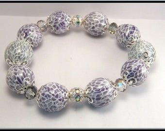 Bracelet élastique perle parme effet mozaïque en fimo, FDP inclus