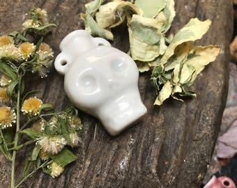 Porcelain Skull Vessel by Joan Eckard