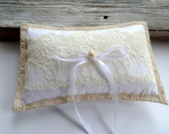 White ringbearer pillow with vintage ivory wedding lace over white