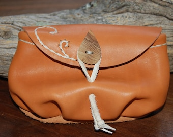 small orange leather pouch