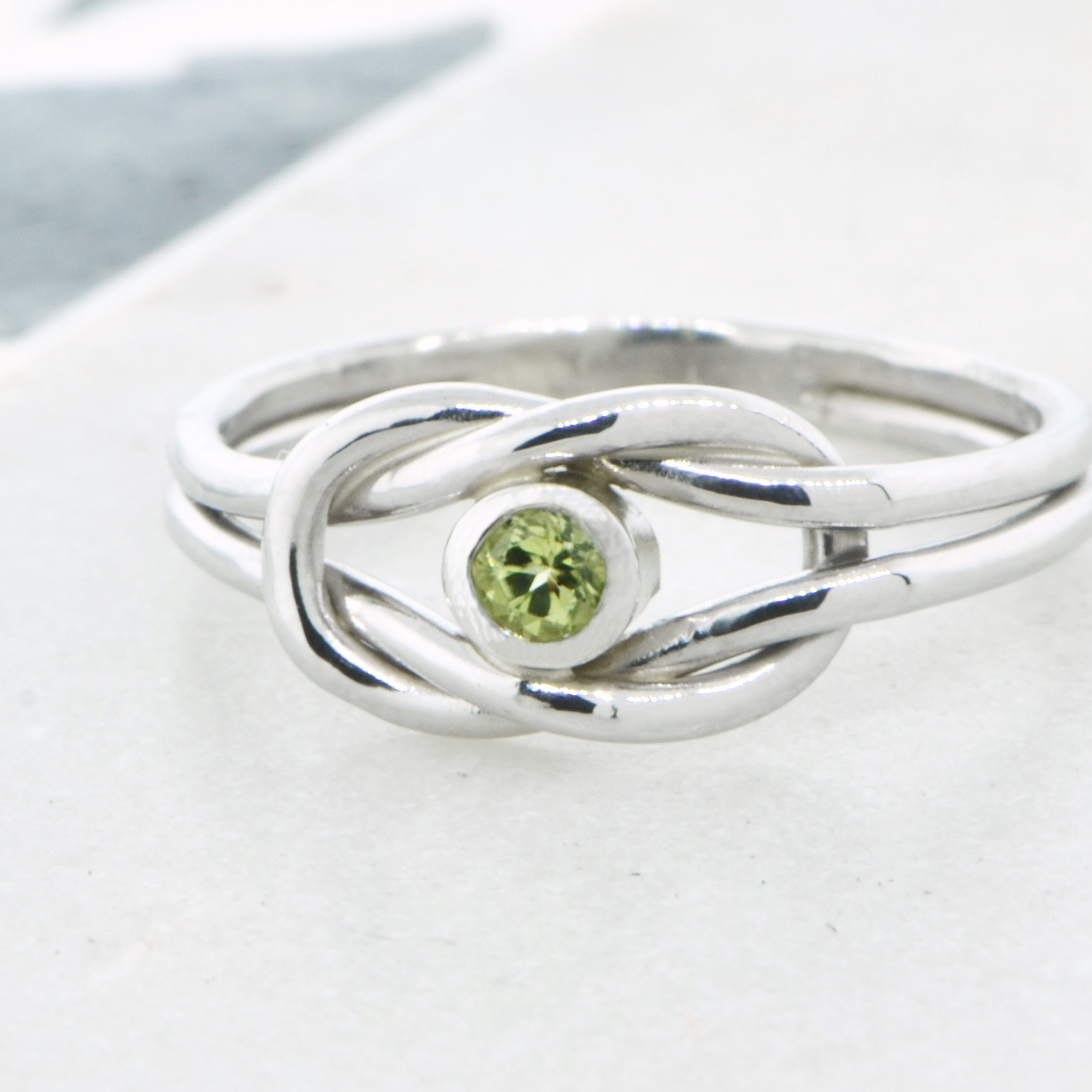 her symbolic she of with mothers beautiful deep amazing ring in pin wears to birthstone has white gold love most as stone diamonds close the this for is remind bypass infinity children gifts