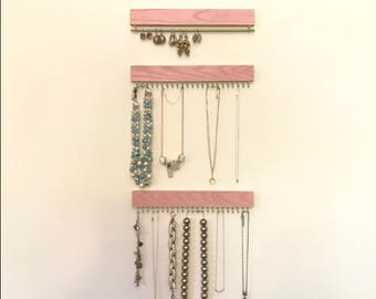 Set of three blush pink (with gold/brass or silver/nickel) display racks: two for necklaces and bracelets, one for earrings (wall hanging)