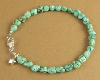 Turquoise nuggets bracelet. Star charm. Blue/green. Fine & sterling silver.
