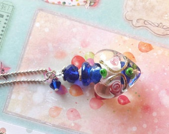 A pretty silver Lampwork, carved glass vial necklace