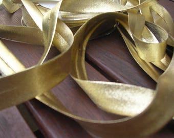 Gold Lurex bias by the yard