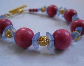 Love's First Blush bracelet - pink vintage wood, blue Czech glass, gold-toned