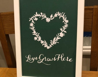 Love grows here papercut
