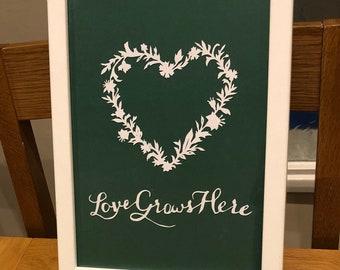 Love grows here papercut