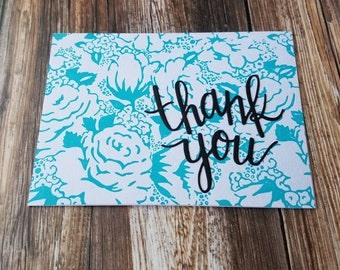Letterpressed flowers with thank you sentiment