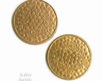 Textured brass disks with faint floral design. 22mm. Package of 2. b9-2342(e)