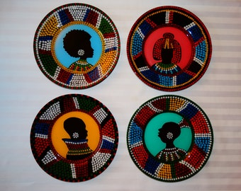 Set of four plates handpainted - African designs