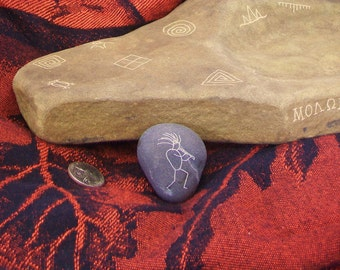 Tribal themed engraved river rock
