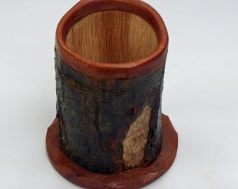 Pencil holder made from a beaver-chewed log.