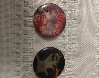 Two vintage rock and roll pins featuring Venom
