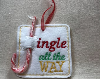 Candy cane holder, embroidered  'Jingle all the way'.