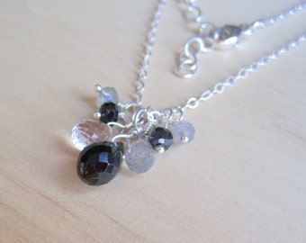 Gemstone cluster necklace in black and neutral colors on sterling silver