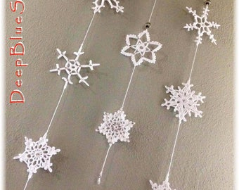 Hanging decoration with 8 handmade crochet snowflakes