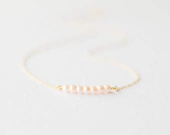Delicate gold pink pearl necklace