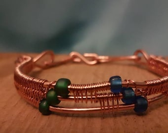 Copper wire weave bangle with seed beads