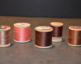 Coats and Clark's Wood Spools with Brown and Peach Thread