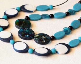 A set of two striking resin necklaces – bold, colourful & versatile.