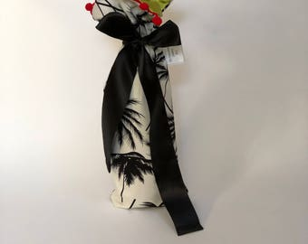 Stylish and fun reusable wine gift bag - black & white palm trees with a red pompom fringe