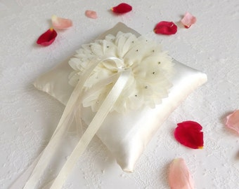 Ivory wedding ring pillow with chiffon flower decorated with swarovski crystals. Floral ring bearer.
