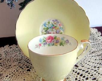 Royal Grafton by A.B.Jones Un-named Light Yellow with multi color flowers Bone China Cup and Saucer