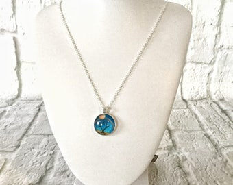 Necklace, sterling silver chain with cobalt blue background, sun and tree charm.