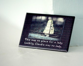 """Rectangle Refrigerator Magnet Antique Porcelain Doll """"This Was No Place For A Lady. Luckily, Claudia Was No Lady."""""""