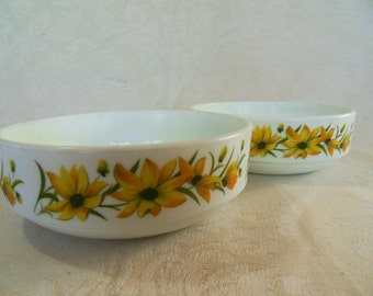 Two cheerful vintage Pyrex cereal bowls with yellow flowers
